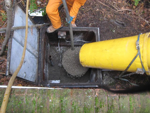 Cement mixer being used to fill a tank