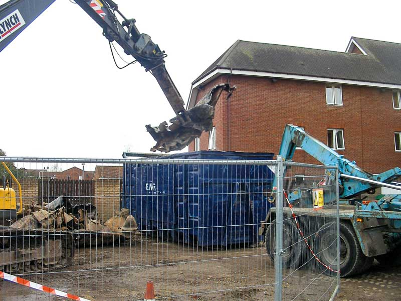 Removing all the contaminated material to an approved landfill site