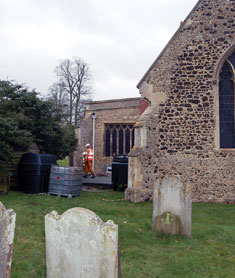 DP FTS burying a heating oil tank in the shadow of St Mary's Church