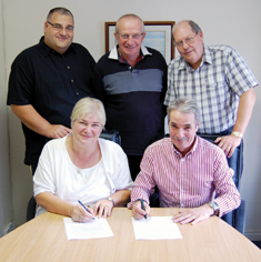 Signing the agreement Back Row L to R: Nigel Plumb, director, DP Fuel Tank Services; John Moore, director, DP FTS; Dan Macdonald, director, Repair Protection and Maintenance. Front Row L to R: Kathy Early, managing director, DP FTS; Peter Hodgson, director, RPM.
