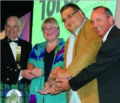 Kathy Early and Nigel Plumb, collecting the award