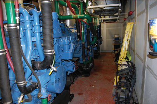 Generator room with tank behind panel on right